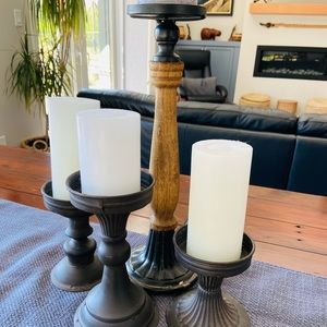 4 vintage/farmhouse style candle holders.